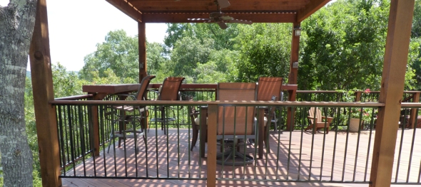 Tigerwood deck with pergola and iron rails