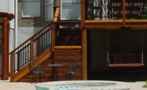 Deck stairs with landing and swing hung below elevated deck