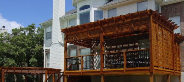 Deck with pergola and additional pergola next to pool