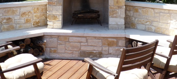 Austin outdoor flagstone fireplace with bench seating