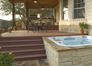 Hot tub spa with deck and covered patio