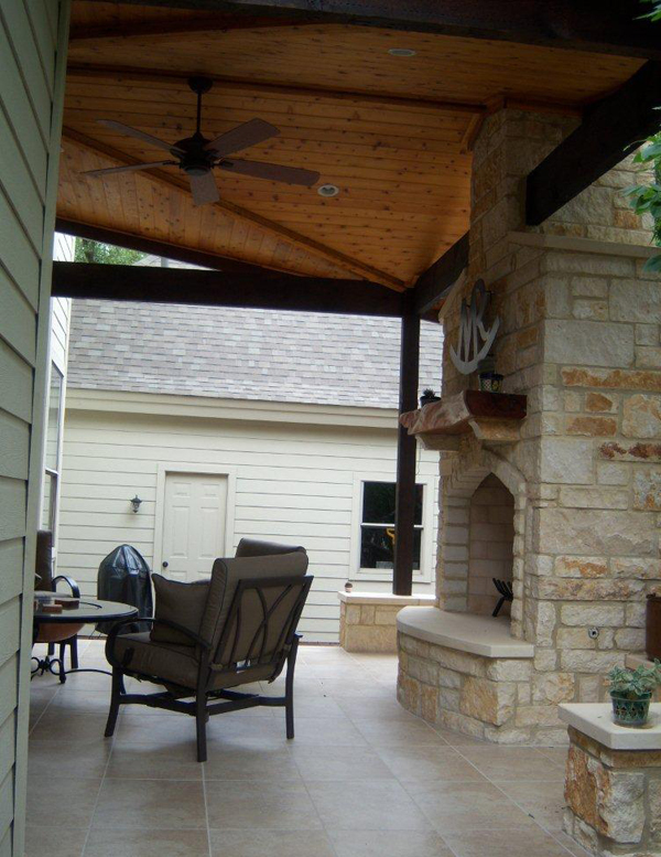 Austin flagstone outdoor fireplaces austin decks for Covered porch with fireplace