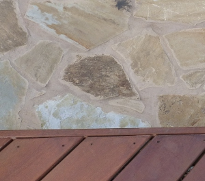 Oklahoma Buff Peach flagstone patio adjoining tigerwood deck