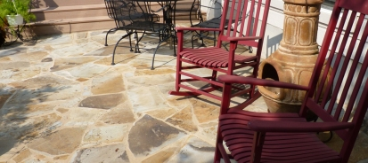 Austin flagstone patio with red rocking chairs