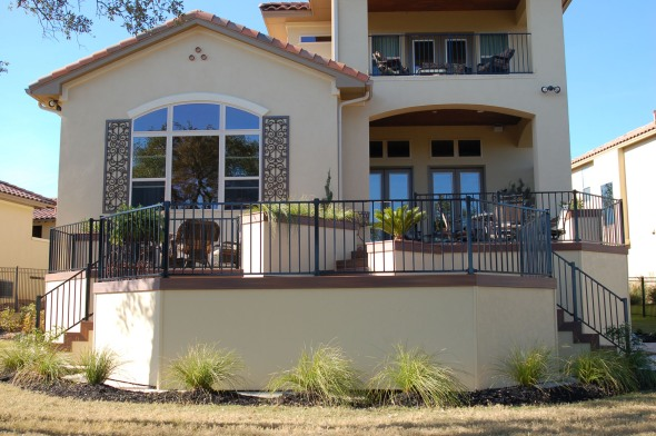 Austin deck multi-level IPE deck with planters and stucco skirting