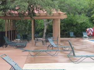 Pergola alongside pool deck in Steiner Ranch