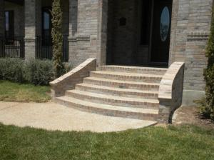 This photo shows the flared steps and wider, more welcoming entrance we provided.