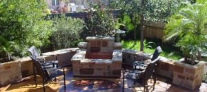 This stunning stone fire pit by Archadeck of Austin doubles as a planter and water feature as well.