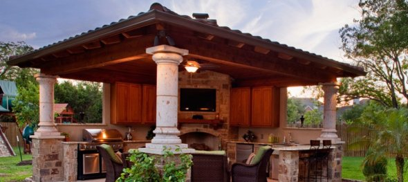 covered patio cabana with outdoor fireplace austin