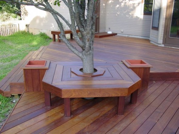 Austin seating bench around integrated tree