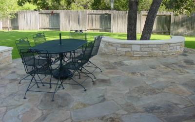 Flagstone patio in cedar park with built-in benches
