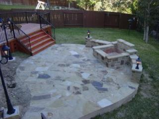 This flagstone patio in Steiner Ranch incorporates a water feature that can also be used as a fire pit