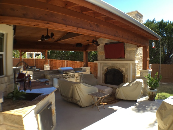 Lago Vista patio cover with outdoor fireplace and kitchen