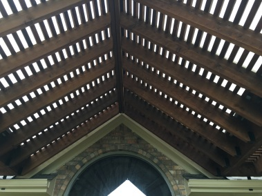 Detail image of gabled roof on pergola.