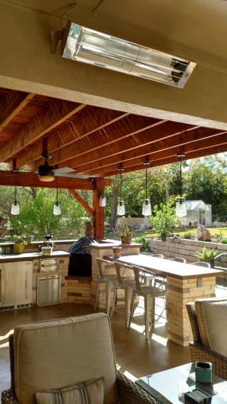 Austin porch and outdoor kitchen space showin infrared heating