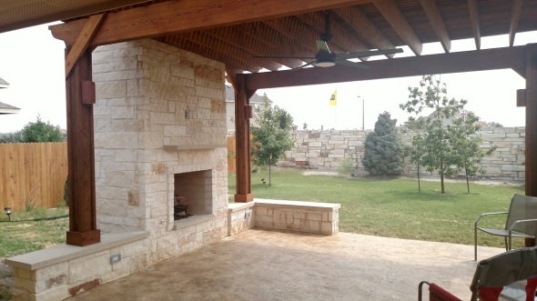 Austin patio cover with outdoor fireplace and privacy screen