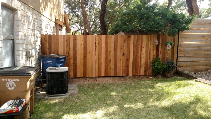 we wrapped up this project by replacing about 15-20 feet of the clients' wood fence, gates and hardware