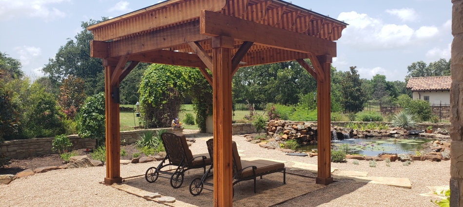 Covered Pergola Creates Idyllic Setting Beside Koi Pond in Georgetown, TX.